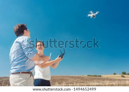 Crew operating a drone to utilize it for a photo or film shoot Stockfoto © Kzenon