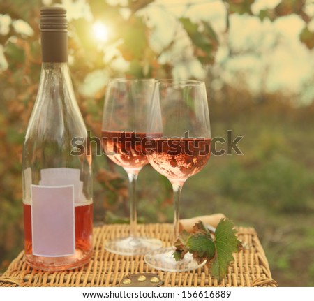 two glasses and bottle of rose wine in autumn vineyard on marble stock photo © dashapetrenko