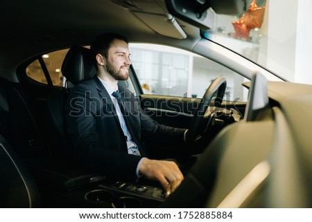 Portrait of handsome caucasian male taxi driver wearing uniform  Stock photo © deandrobot