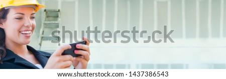 Női beszállító visel védősisak szalag létra Stock fotó © feverpitch