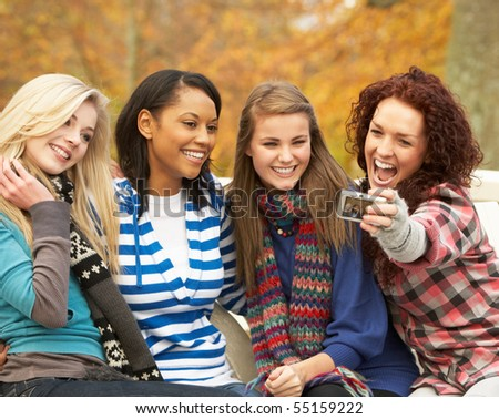 Group Of Four Teenage Girls Taking Picture With Camera Sitting O stock photo © monkey_business