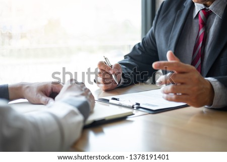 executive reading a resume during a job interview and businessma stock photo © freedomz