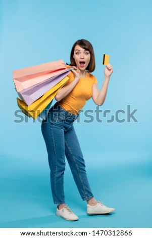 Young female shopaholic in casualwear boasting with credit card Stock photo © pressmaster