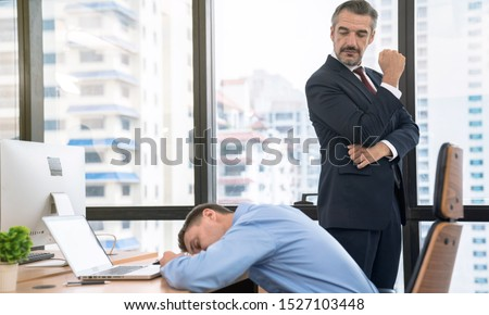 Stock photo: Tired businessman sleeping while working with laptop and writing