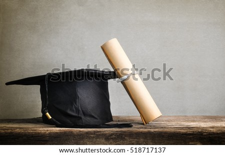 Graduation cap, Hat with degree paper on white wood table, abstr Stock photo © Freedomz