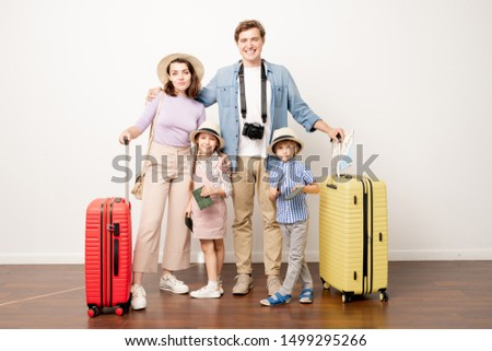 Studio shot of young family of four in casualwear going to have journey Stock photo © pressmaster