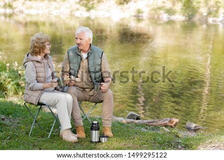 зрелый привязчивый человека женщину чай Бутерброды Сток-фото © pressmaster