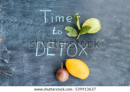 TIME TO DETOX chalk inscription on the wooden table fruits: mango, passion fruit and guava. Health C Stock photo © galitskaya