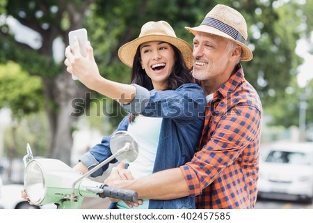 Side view of beautiful happy young woman sitting on man bicycle handlebars on beach in the sunshine Stock photo © wavebreak_media