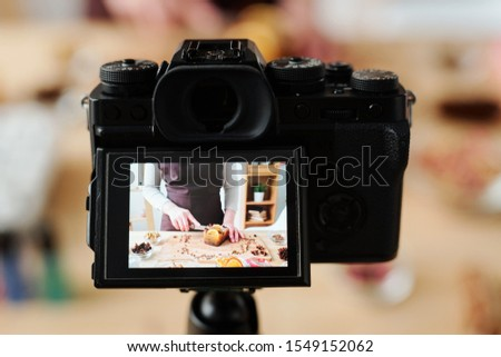 craftswoman in camera recording video of master class of making handmade soap stock photo © pressmaster