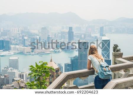 Young woman traveler at the peak of Victoria against the backdrop of Hong Kong Stock photo © galitskaya
