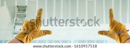 Contractor Hands In Leather Gloves Framing Empty Room of House Stock photo © feverpitch