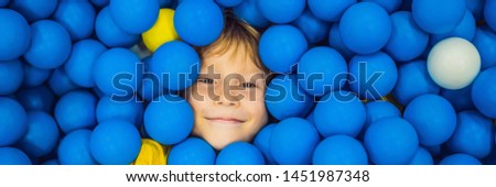 BANNER, LONG FORMAT Child playing in ball pit. Colorful toys for kids. Kindergarten or preschool pla Stock photo © galitskaya