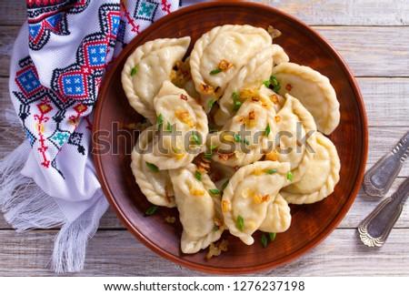 Boiled pierogi (Polish dumplings) stuffed with cabbage and mushr Stock photo © joannawnuk