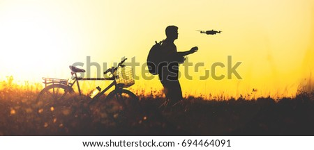 Father and son operating the drone by remote control. Young man with little boy flying drone, enjoyi Stock photo © galitskaya