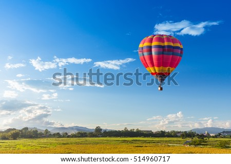 hot air balloon over the green paddy field. Composition of nature and blue sky background. Travel co Stock photo © galitskaya