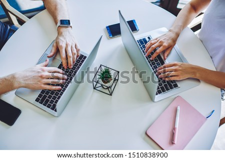 Professional IT developer downloads files, chats online in social networks, bloggs and surfes intern Stock photo © vkstudio