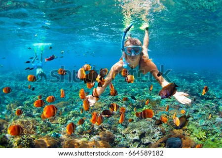 Happy man in snorkeling mask dive underwater with tropical fishes in coral reef sea pool. Travel lif Stock photo © galitskaya