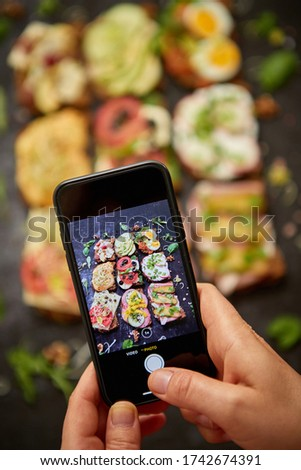 Assortment of home made sandwiches with various toppings. With colorful fresh vegetables Stock photo © dash