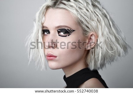 portrait of beautiful futuristic style woman looking at camera a stock photo © hasloo