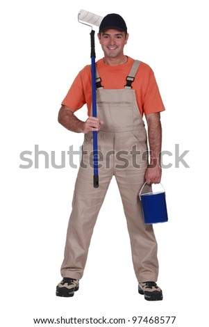 full length portrait of painter holding tin of paint and roller stock photo © photography33