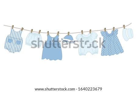 Children's overalls hanging on a clothesline on white background Stock photo © RuslanOmega