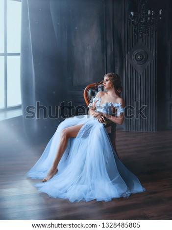 woman sitting in chair waiting for makeup artist in full makeup stock photo © wavebreak_media