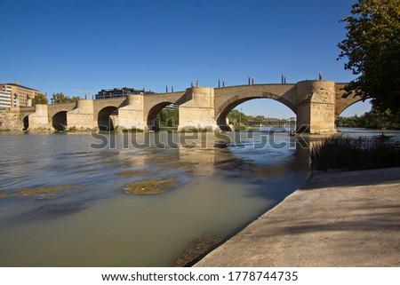 Stone Bridge (Puente de Piedra) over river Ebro in Zaragoza, Spa Stock photo © aladin66