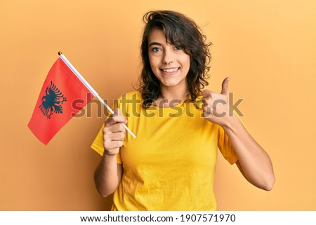 albania national flag thumb up gesture for excellence and achiev Stock photo © vepar5