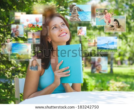 portrait of young happy woman sharing her travel vacation photo stock photo © hasloo