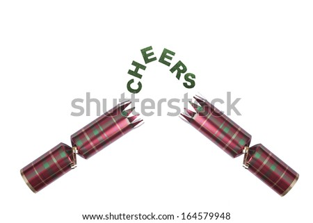Isolated Christmas Cracker in tartan pattern with cheers text Stock photo © jenbray