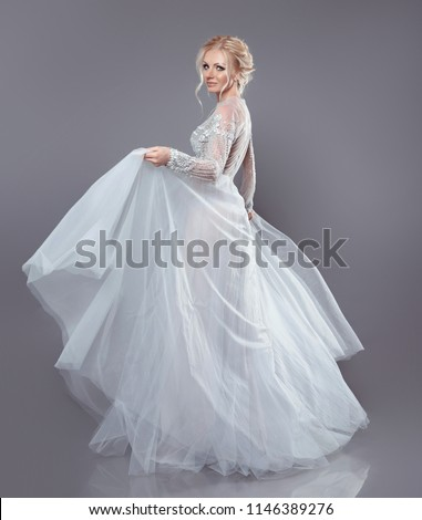 fashionable bride model in wedding dress isolated on gray backgr stock photo © victoria_andreas