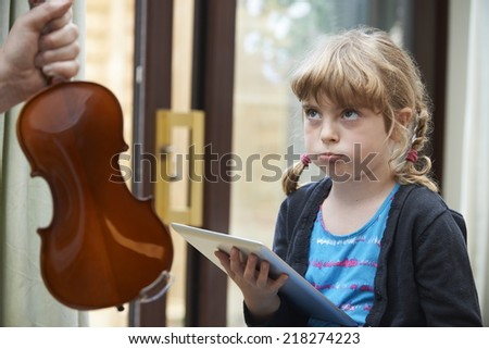 Young Girl Would Rather Play On Digital Tablet Than Practise Vio Stock photo © HighwayStarz