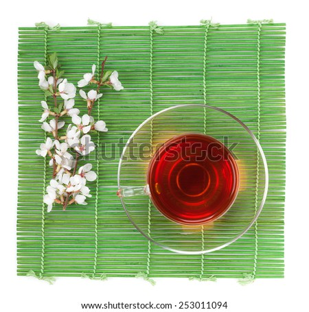 japanese green tea and sakura branch over mat and bamboo table stock photo © karandaev