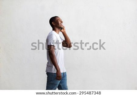 yandan · görünüş · genç · konuşma · telefon · genç · gündelik - stok fotoğraf © deandrobot