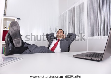 businessman relaxing at the office with his shoes on the desk Stock photo © deandrobot
