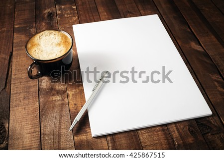 Blank white paper on clipboard with cup of coffee, retro filter  Stock photo © happydancing
