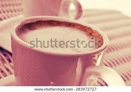 cups of cappuccino or caffe macchiato on a table, cross processe Stock photo © nito