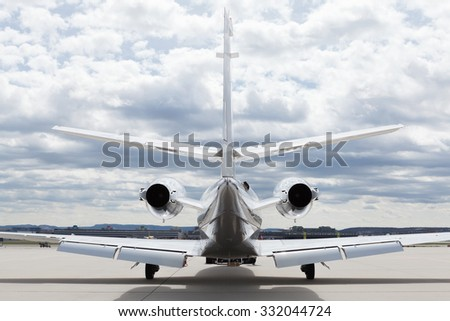 Aircraft learjet Plane in front of the Airport with cloudy sky Stock photo © juniart