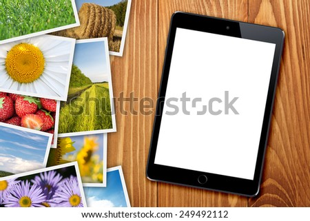 Tablet with blank screen and stack of printed pictures collage Stock photo © karandaev