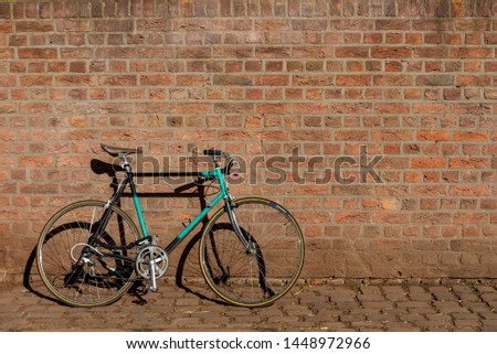 Classic vintage hipster retro bicycle leaning against the street Stock photo © stevanovicigor