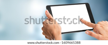Humans hands holding tablet Stock photo © cherezoff