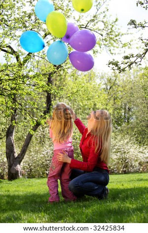 Mother with daughter with sheaf of balloons in  garden in spring Stock photo © Paha_L