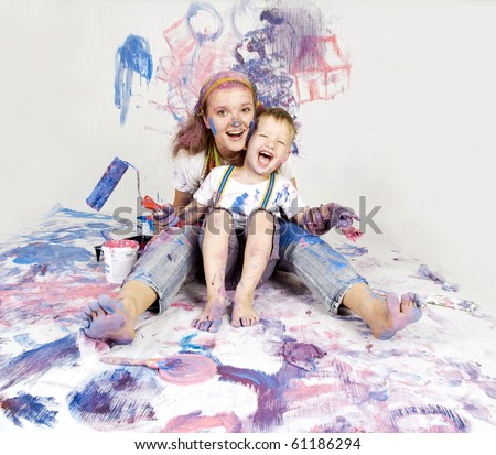 son and mother draw with rollers and brushes on a wall, collage Stock photo © Paha_L