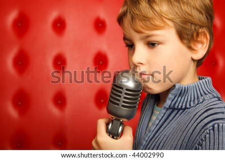 Sad boy with microphone on rack against red wall. Close up. Horizontal format. Stock photo © Paha_L