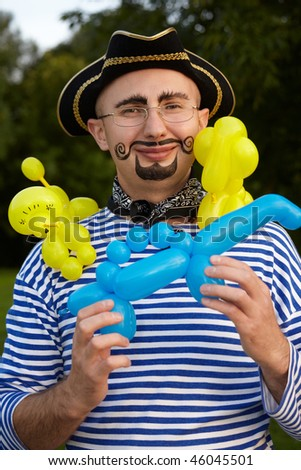 Smiling man with drawed beard and whiskers in pirate suit with three air-ballons Stock photo © Paha_L