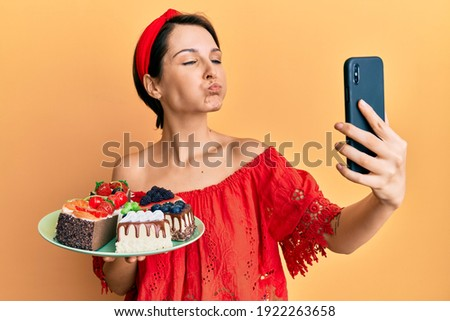 Amusing woman making funny face and taking selfie with tablet Stock photo © deandrobot