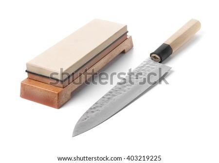 trditional japanese kitchen knife and water stone isolated on w stock photo © leonardi