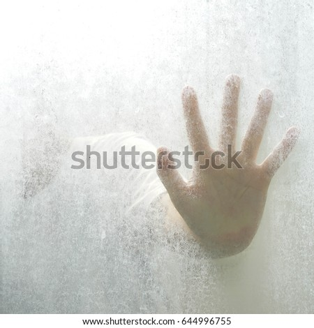 Trapped person, back lit silhouette of hands behind matte glass Stock photo © stevanovicigor