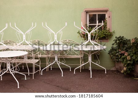 romantic idyllic plant table in the garden with old retro flower pot pots, tools and plants Stock photo © Klinker